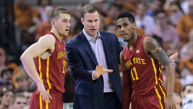 Iowa State head coach Fred Hoiberg, center, talks with Matt Thomas, left, and Monté Morris, right, during the first half of an NCAA college basketball game against Texas on Saturday. Thomas scored a career-high 17 points, and the No. 14 Cyclones won 85-77.