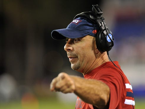 Florida Atlantic coach Carl Pelini reacts during the second half of a Nov. 2012 game against Florida International  at  FAU Stadium.