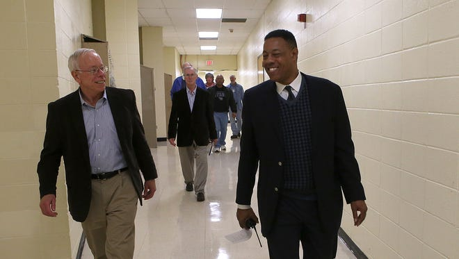 Principal Charles Clark, right, and School Board Chairman Jim Campbell walk down a hallway of Jackson Central-Merry High School on Friday.