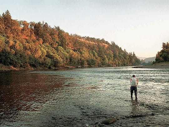 An angler fishes in the Umpqua River.