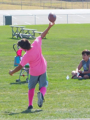 Ready to release the football for a pass Sunday at the White Mountain Sports Complex in Ruidoso.