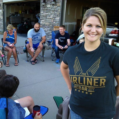 """Several neighbors turned out for """"drinks in the driveway"""" hosted recently by Rachel Schramm (right) at her North Liberty home – and arranged by her online."""