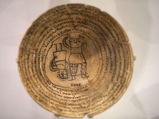 An incantation bowl, also known as a demon or magic