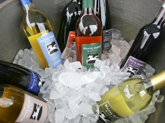 A variety of wines from Whyte Horse Winery are chilling.