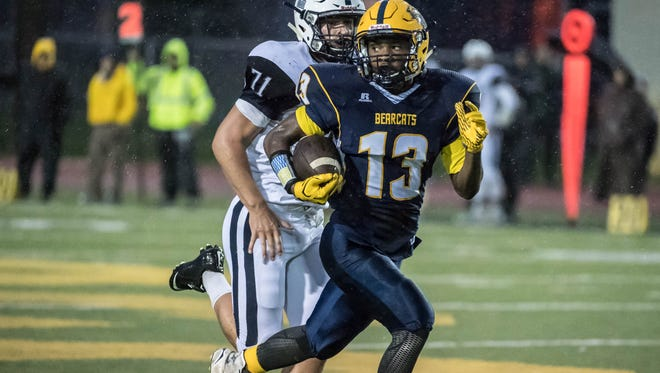 Battle Creek Central's Darrell Banks (13) advances the ball during first half action against Gull Lake last season.
