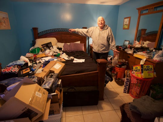 Benjamin Morrow shows off the bedroom he's been staying in.