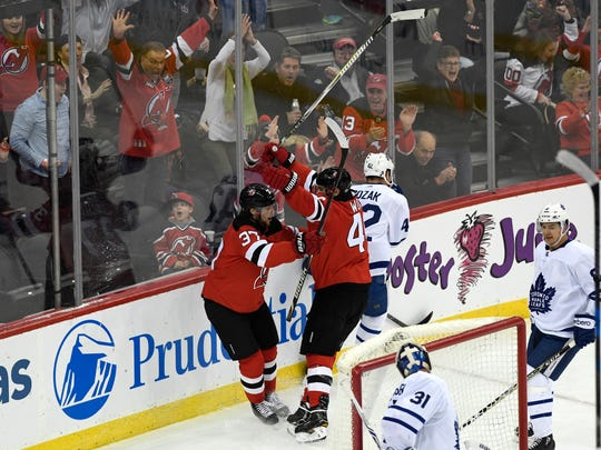 New Jersey Devils center Pavel Zacha (37) and New Jersey