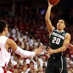 Michigan State Spartans guard Travis Trice (20) looks to move ball past Wisconsin Badgers forward Frank Kaminsky (44) during the first half at the Kohl Center.