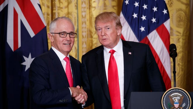President Trump (R) shakes hands with Prime Minister of Australia Malcolm Turnbull (L) during a joint press conference in the East Room of the White House in Washington, D.C, on Feb. 23, 2018.