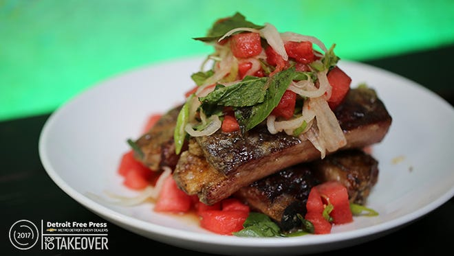The crispy spare ribs at Katoi in Detroit's Corktown neighborhood are first smoked then cooked in a fish-sauce caramel and served with chunks of sweet watermelon, pickled rind and basil.