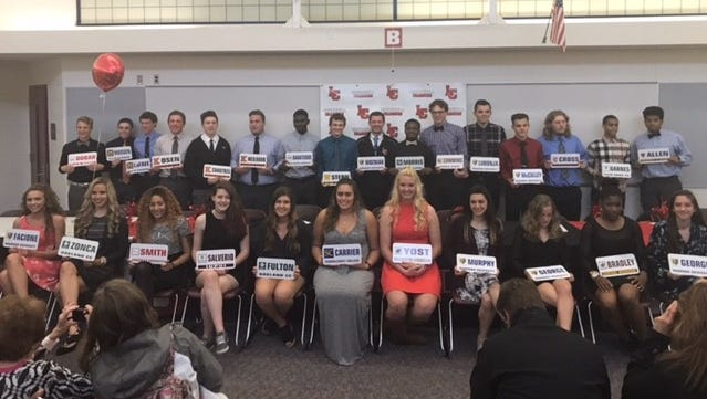 Livonia Churchill student-athletes show where they will be attending college during a recent signing day event.
