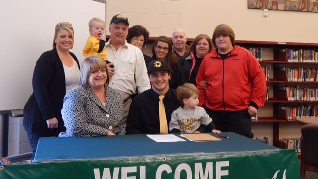 Northridge's Brad Wilson signs his letter of intent.