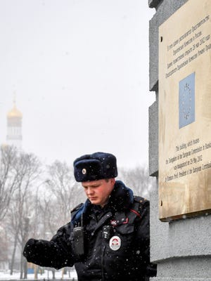 A police officer walks outside the European Union representative office in Moscow on March 27, 2018.