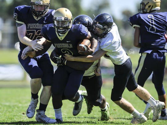 Freehold Boro quarterback Ashante Worthy carries two