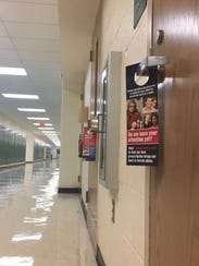 Door hangers about opioid abuse placed on the classroom