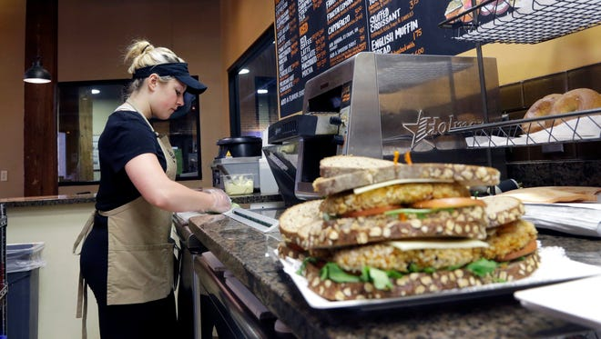 In this March 23, 2016 photo, Kayla Mitchell makes sandwiches at Good Day Cafe in North Andover, Mass. Ten U.S. states still have not regained all the jobs they lost in the Great Recession, even after six and a half years of recovery, while many more have seen only modest gains. The figures help illustrate the uneven nature of the economic rebound since the Great Recession ended in June 2009. They also suggest why many Americans feel the improvement has passed them by.