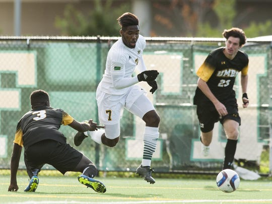 Vermont's Brian Wright dribbles the ball ball between