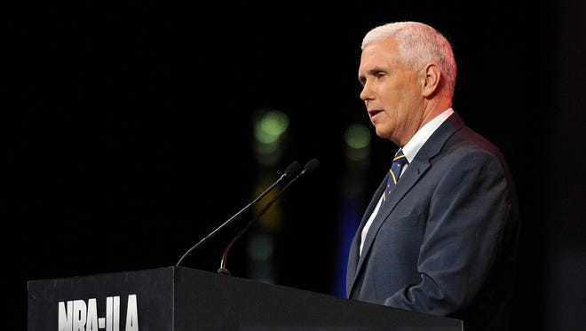 Indiana Governor Mike Pence speaks during the National Rile Association's Leadership Forum inside Lucas Oil Stadium, Friday, April 25, 2014, in Indianapolis.