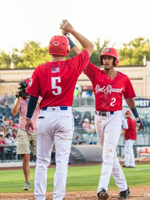 Amarillo Sod Squad's Kamron Willman (right) is congratulated by Max Marusak after both scored on Willman's two-run home run in Friday night's game against the Texas Stix at Hodgetown.