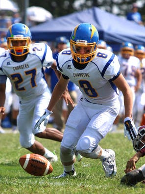 Spotswood's Eddie Rogers (8) looks to dive on a fumble during the first half on Sept. 10, 2016.