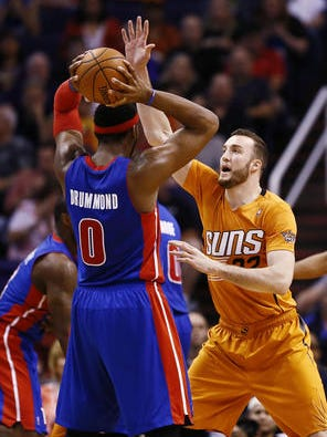 Suns center Miles Plumlee defends Detroit's Andre Drummond, something he will be doing as a USA Basketball Select Team member at the national team's camp in late July.