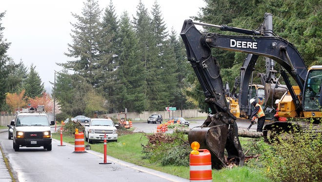 Improvements are underway at Ridgetop Boulevard at its intersection with and Marigold Drive NW on Friday. Plans call for a wider sidewalk, roundabout and landscaping to better handle stormwater from the area.
