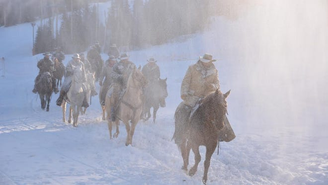 """Horses and riders brave conditions provided by the snow machines at Brian Head Resort simulating the blizzard of 1897 in the iconic """"Old Sorrel"""" story of the founding of Southern Utah University."""