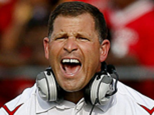 Rutgers coach Greg Schiano reacts to play during the first half of an NCAA college football game against Cincinnati on Monday, Sept. 7, 2009, in Piscataway, N.J. Cincinnati won 47-15.