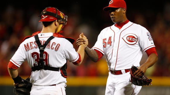 Reds relief pitcher Aroldis Chapman is congratulated Tuesday night by catcher Devin Mesoraco.