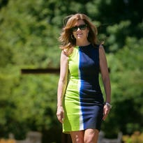 Jane Rubini wears a long, olive green dress from Ralph Lauren with a camel leather braided belt by Michael Kors and brown leather gladiator sandals by Franco Sarto.