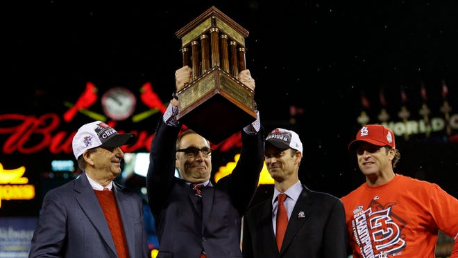 GM John Mozeliak (second from left) and the Cardinals have been to the NLCS four consecutive years.