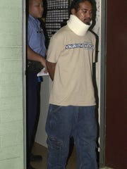 In this November 2003 file photo, Guam Police Officer