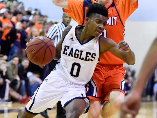 """Independence's McKyan """"Mac"""" James (0) advances past Summit's Hayden Turner (0) during the second half at Centennial High School in Franklin, Tenn., Tuesday, Feb. 28, 2017."""