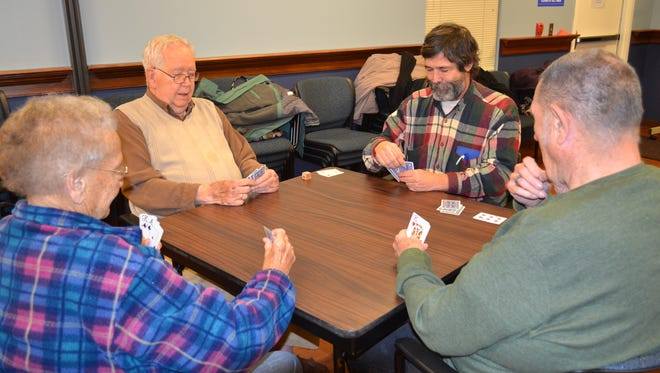 Euchre Game Night at Ida Rupp Public Library is held the second and fourth Tuesday of every month, and players of all levels are welcome. Playing here, clockwise from lower left, are Esther Milligan, Bob McConnell, Mike Lerro and John Tornow.