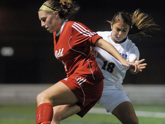 Penfield's Emily Ebersol, left, shields the ball from Webster Schroeder's Adriana Conciardo.