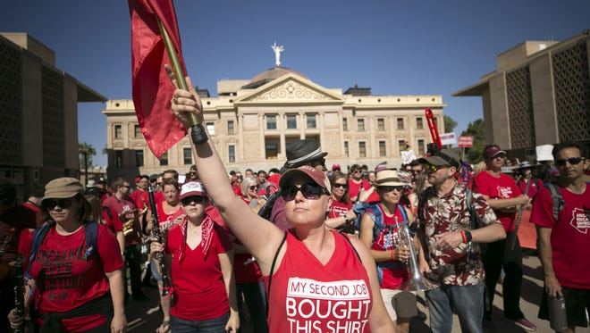 Jil Schroeder, a teacher at Gilbert Public Schools, leads the #RedForEd Sprit Band during the sixth day of the Arizona teacher walkout at the Arizona state Capitol in Phoenix on Thursday, May 3, 2018. Today will likely bill the final day of the walkout as Governor Ducey signed an education funding bill into law early Thursday morning.