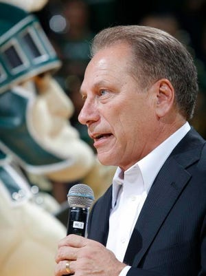 Michigan State coach Tom Izzo talks to the crowd before an NCAA college basketball scrimmage, Friday, Oct. 23, 2015, in East Lansing, Mich.