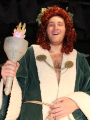 """Adam Lail as the Ghost of Christmas Present in Stayton High School's production of """"A Christmas Carol."""""""