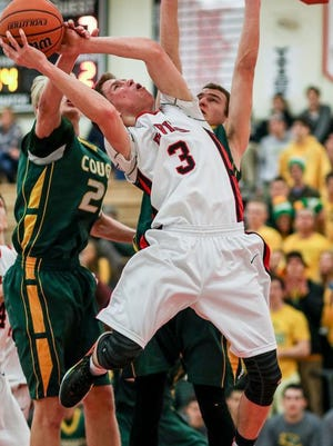 Hunterdon Central's Colin McNeil (3) is fouled by Montgomery's Danny Engels (20) at Hunterdon Central on Feb. 2.