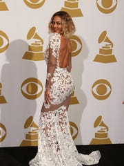 Wearing a Michael Costello dress, Beyonce poses at