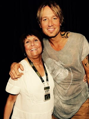 Betty Mate of Irondequoit meets Keith Urban at a Canandaigua concert, after her son surprised her with VIP tickets.