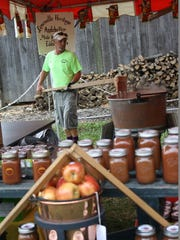 Eddie Mathes stirs a cauldron of apple butter over