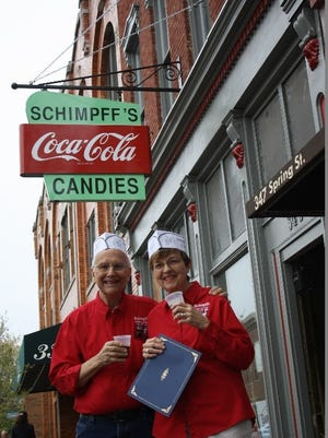 Warren and Jill Schimpff unveiled their newly refurbished sign at Schimpff's Confectionery  in April.