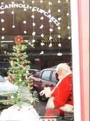 Shops decked the halls for the Old Fashioned Christmas event on Saturday in downtown New Albany.  Dec. 10, 2016