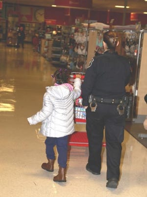 A hero and her helper shop at a local Target stores.