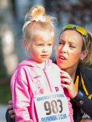 Maci Patterson, 3, and her mother Molly are shown at the Flannery's 1K race in Greencastle. The Patterson family, from Dayton, Ohio, was in town to visit Molly's father, Frank Klink, who lives in Greencastle.