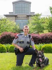 Mason Police Officer Michael Sechrist and K-9 officer Banshee