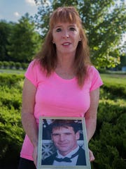Lawyer Patricia Rouse holds a photo of her brother James, who died of Legionnaires' disease at age 52. Rouse has filed several official requests with the city of New York for information about how he contracted the disease.