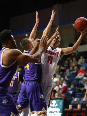 Belmont's Kevin McClain goes up for a heavily-contested shot in Thursday's game against Tennessee Tech at Curb Event Center.