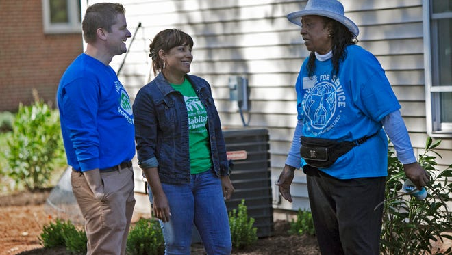 The Rev. Jeremy Montgomery, president and Executive Director of Habitat for Humanity of Greater Plainfield and Middlesex County; home owner Brenndie Estevez and volunteer Barbara Pittman.